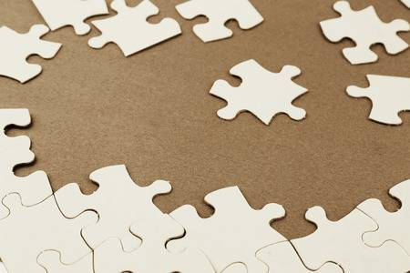 29595254-loose-jigsaw-puzzle-pieces-on-brown-background-.jpg